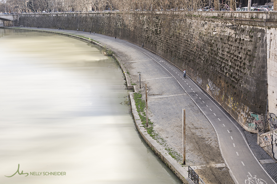 the tiber river and the bike lane seen from bridge ponte sisto in rome italy