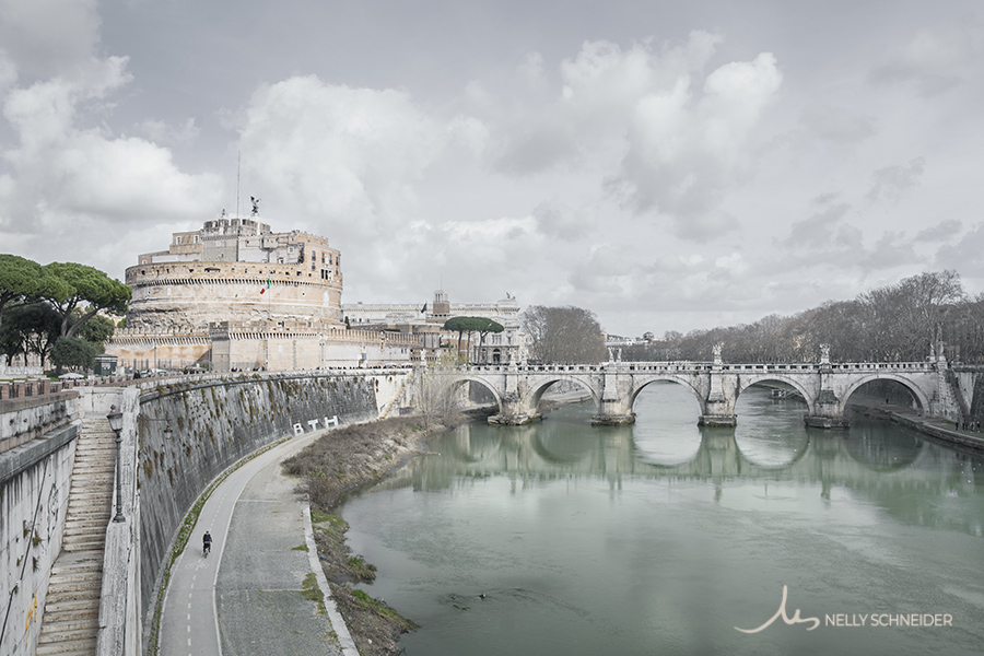 panoramic view of the building castello sant'angelo in rome next to the bridge and the tiber river