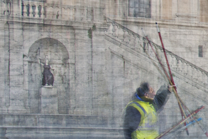 a man holding some brooms is the detail of the fine art print beneath the surface image from nelly schneider photography