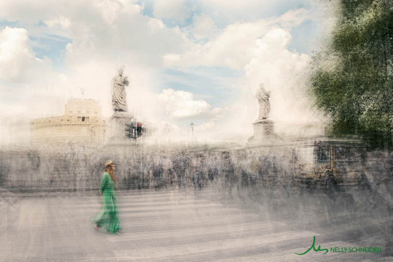 a woman wearing a green dress crosses the street at piazza sant\\\'angelo in rome