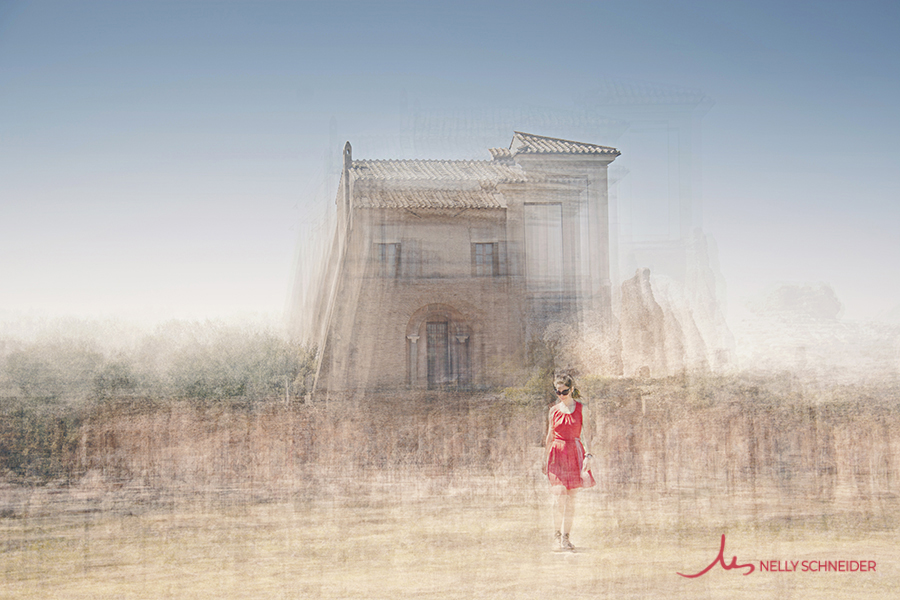 a woman wearing a spring red dress and sunglasses is walking on the palatino hill in rome on her back casina farnese building