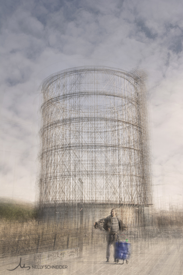 a man and his shopping cart is standing on the bridge ponte della scienza and is taking is jacket off on the back the gasometer
