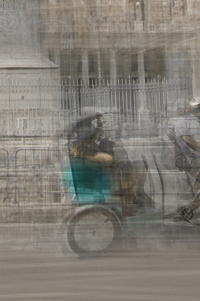 a taxi bike for tourists is passing by in piazza colonna in rome