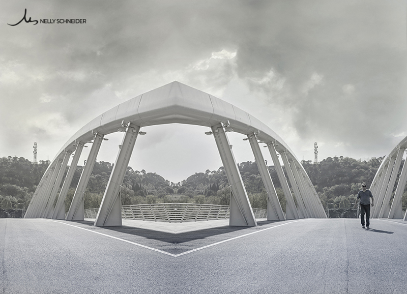 a fantastic view of a mirrored bridge ponte della musica in rome italy with a man walking towards the camera