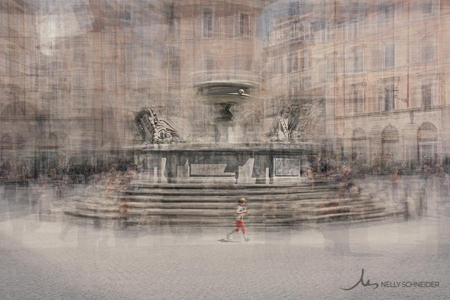 a kid is running in piazza santa maria in trastevere in rome
