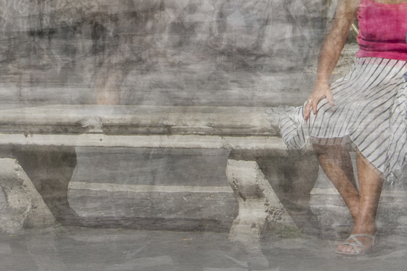 detailof a woman seating on a bench