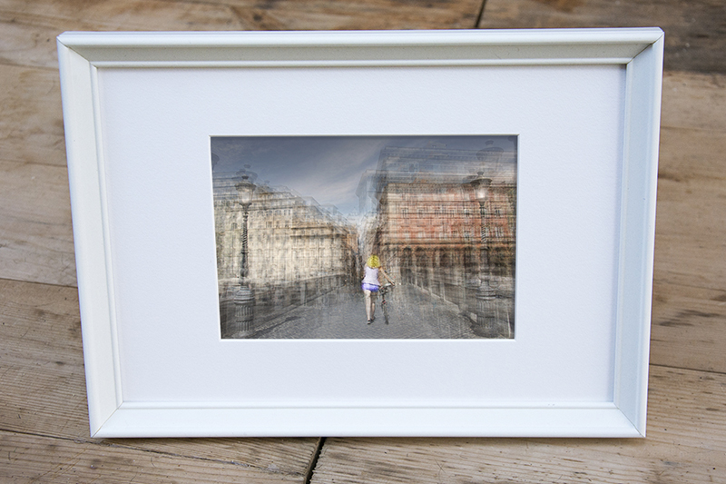 a framed fine art photography print of a woman walking on bridge ponte sisto in rome