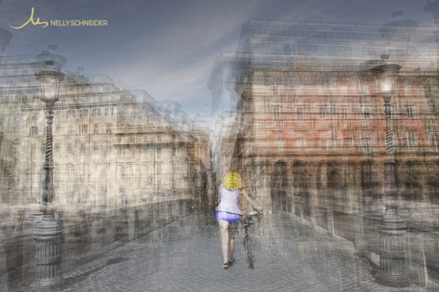 a woman wearing shorts is walking with her bicycle on bridge ponte sisto in rome italy
