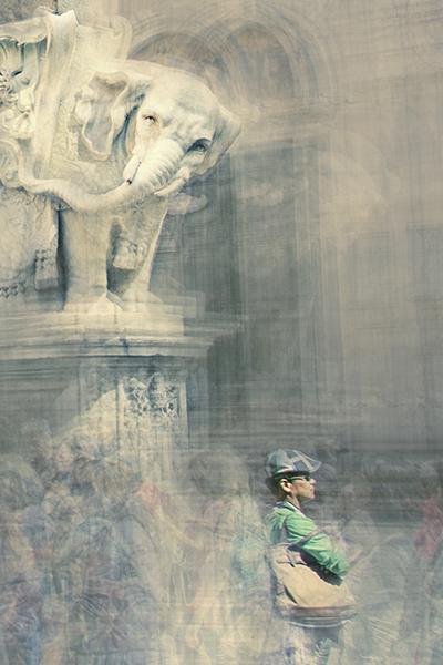 a man is standing in piazza della minerva in rome italy