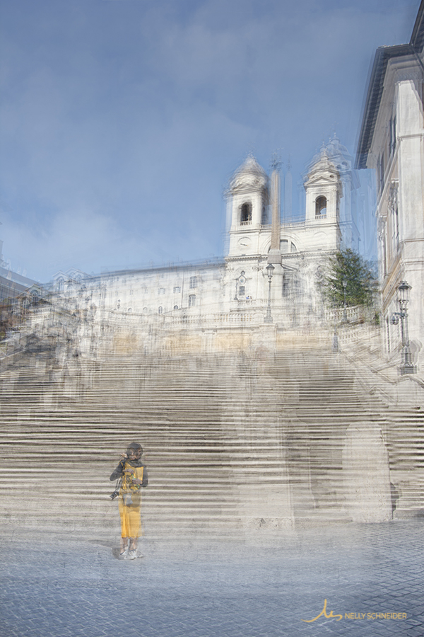 a woman is standing at the bottom of the spanish steps in rome italy